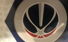 The Washington Wizards logo adorns a student's bedroom wall.