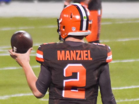 Johnny Manziel warms up before the game during his time in the NFL.