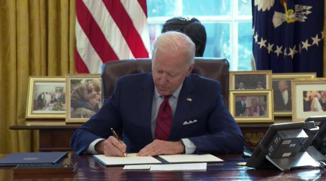 "President Joe Biden signs ""Executive Order on Strengthening Medicaid and the Affordable Care Act"" at the White House on Jan. 28."