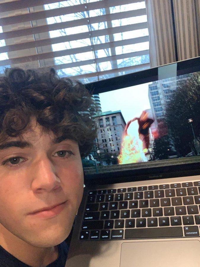 Junior Ethan Fayne watches