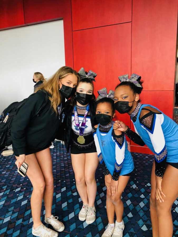 Sophomore Jolie Graham poses with teammates at her cheer competition in Ocean City.