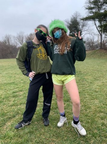 Senior Jamie Stern and junior Emily Levine dress up for practice on St. Patrick