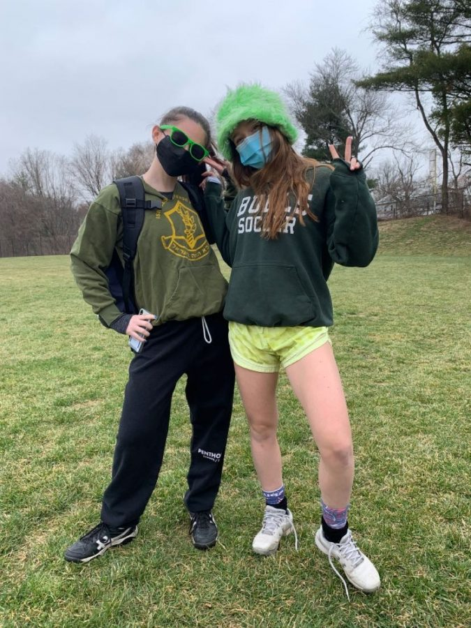 Senior+Jamie+Stern+and+junior+Emily+Levine+dress+up+for+practice+on+St.+Patricks+Day+to+show+their+spirit.