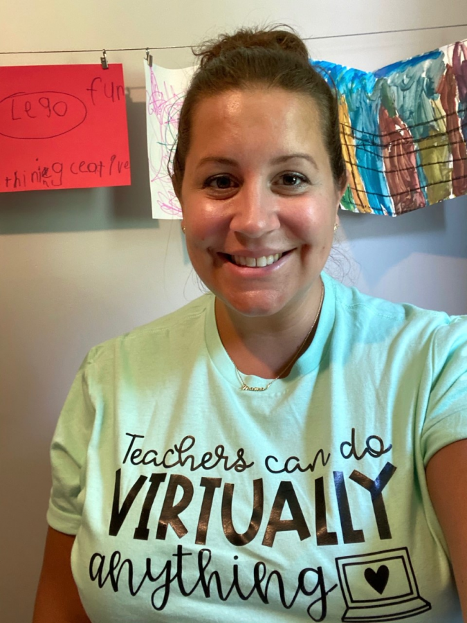 Social studies teacher Christina Rice smiles at her virtual teaching set up in her home on the first day of the current school year.