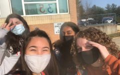 Seniors Leah Boxman, Nadia Emran, Erin Chang and Abbey Damonte meet outside before school.