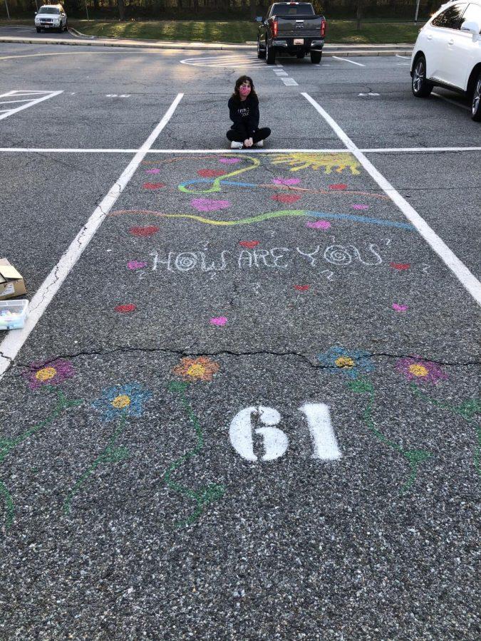 Senior Maddie Etman displays her self-designed parking spot on April 7.