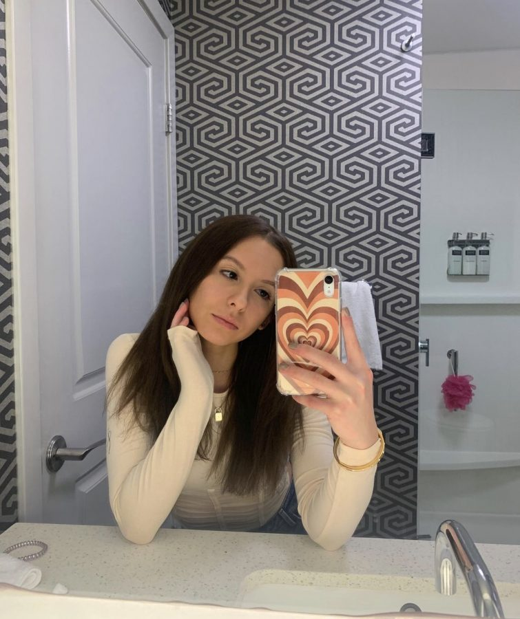Senior Anela Trakic takes a mirror picture after dying her hair darker.