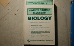 An AP Biology book like the one that would be used to study for the AP exam awaits reading.