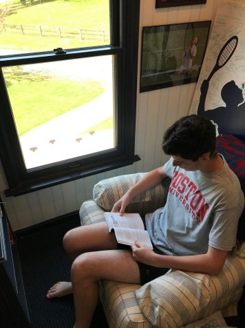 Noah Lenkin reads a book that will help prepare him for college at Boston University