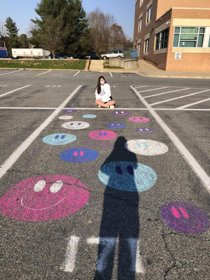 Senior+Erin+Chang+admires+her+parking+spot+with+chalk-drawn+smiley+faces+on+Apr.+7.