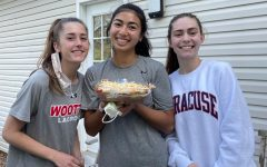 Senior captains Zara Chavoshi, Paige Abid and Sarah Woodward present the traditional pre-game bean dip.