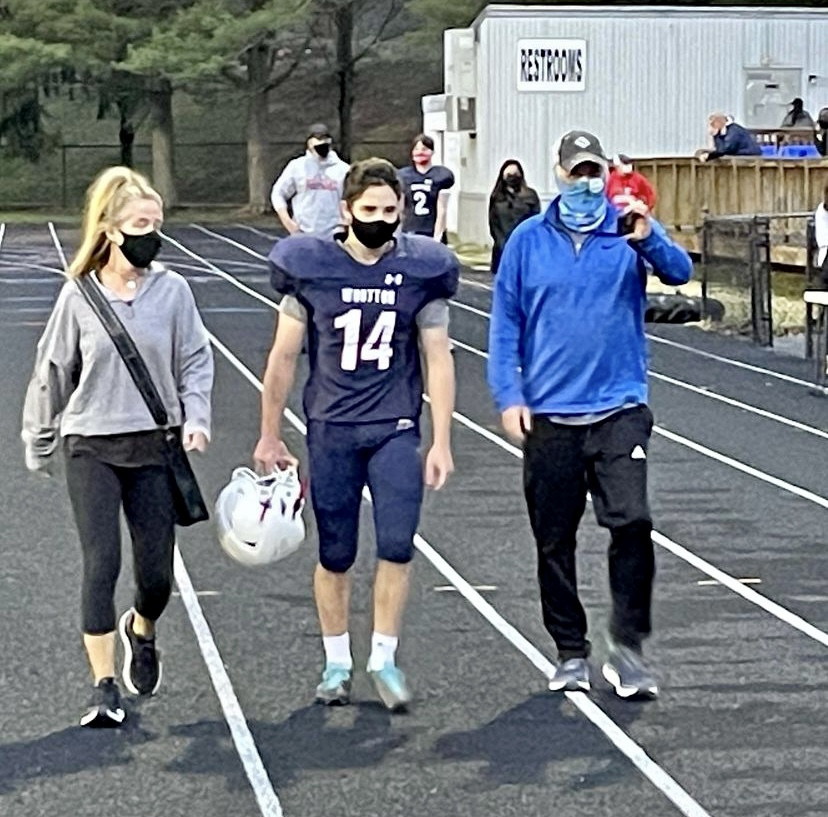 Senior Noah Pizer walks with his family for senior night during halftime of the game against Rockville on Apr. 9.