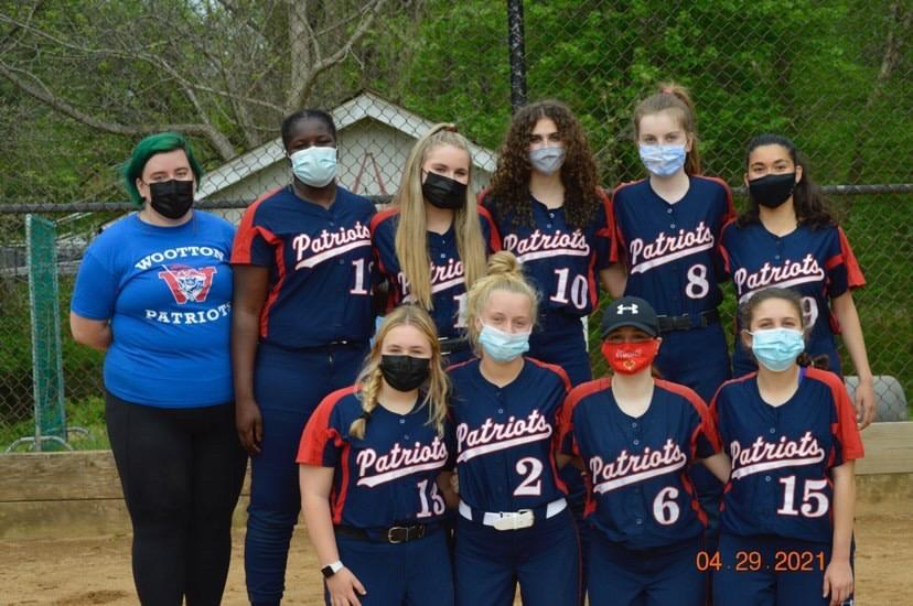 The junior varsity softball team gathers.