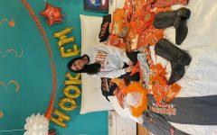 Senior Riya Kholi celebrates committing to college with bedroom decoration.