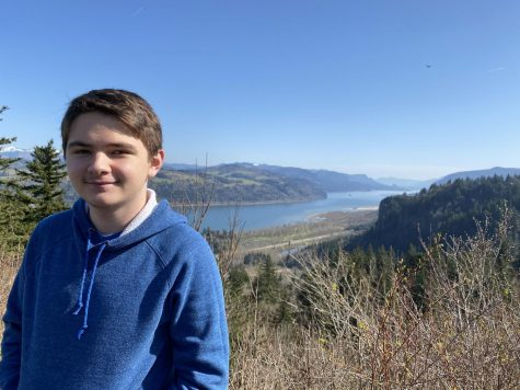Junior Luke Jordan poses in front of the Columbia River in the outskirts of Portland, Oregon.