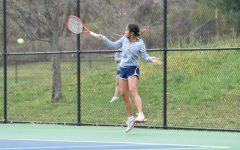 Junior Helen Sarikulaya returns a serve in a practice match.