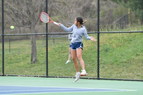 Junior Helen Sarikulaya returns a serve in a practice match.