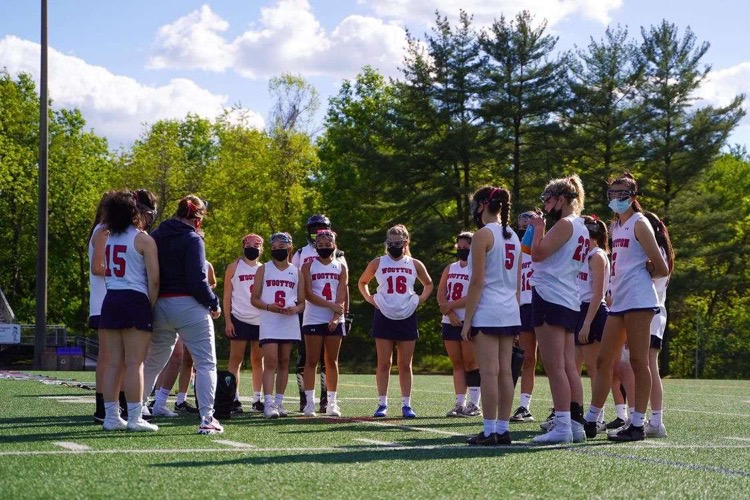 Coach Zucchini discusses the game plan with the team before the game on May 7.