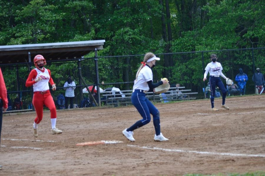 Lizzie Nelson catches the ball on first base to get the out in her game against Blair.