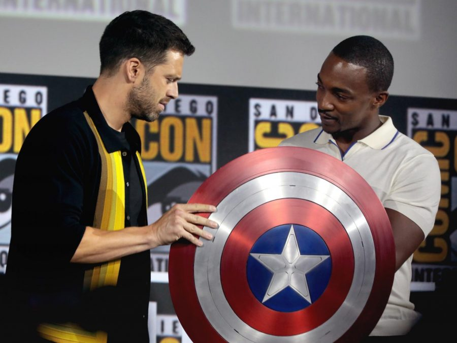 Anthony+Mackie+and+Sebastian+Stan+observe+Captain+America%27s+shield.