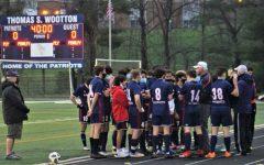 Boys' varsity soccer huddles before a game.