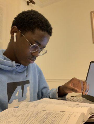 Junior Aidan Caesar studies for his AP Chemistry test.