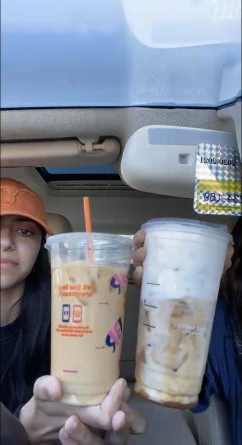 Senior Riya Kohli and senior Ella Teichberg display their Dunkin' Donuts and Starbucks coffees.