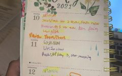 Senior Betty Berhane uses her planner to keep track of her assignments for the week