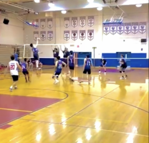 Sophomore Jared Su goes up for a spike to try to get the team back in the game.