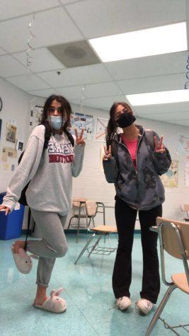 Seniors Rozhin Fadae and Nazanin Teheri joke around on their last Monday of high school.