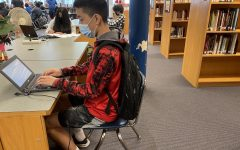Sophomore Nick Peng does his English homework in the library as he deals with adjusting to in-person learning.
