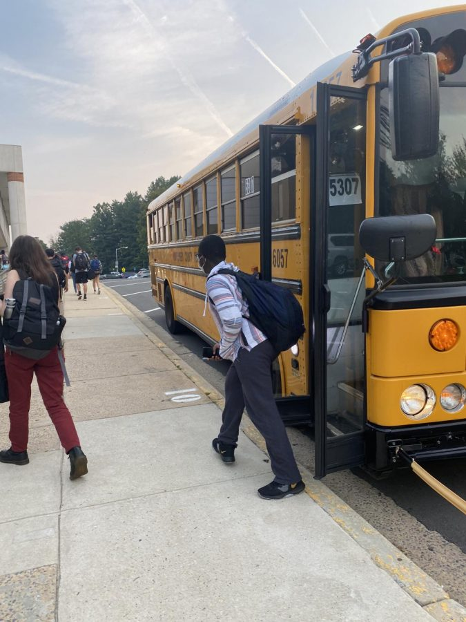 """Students exit bus 5307 in the morning. """"We saw for sure the first week of school, there were some buses coming in late. As of this week, there is one bus we"""