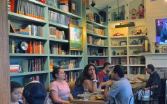 The front dining room of Sisters offers interesting items to look at when conversation gets boring, such as books, antiques and family photos. The multi-room structure of the restaurant creates a quaint atmosphere and a home-like feel.
