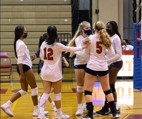 The team huddles after winning a point against Watkins Mill on Sept. 9.