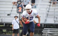 Sophomore running back Mathew Cortes takes a handoff on second down in the Sept. 9 game at Poolesville. Cortes would end up having 14 carries for 97 yards for the Patriots.
