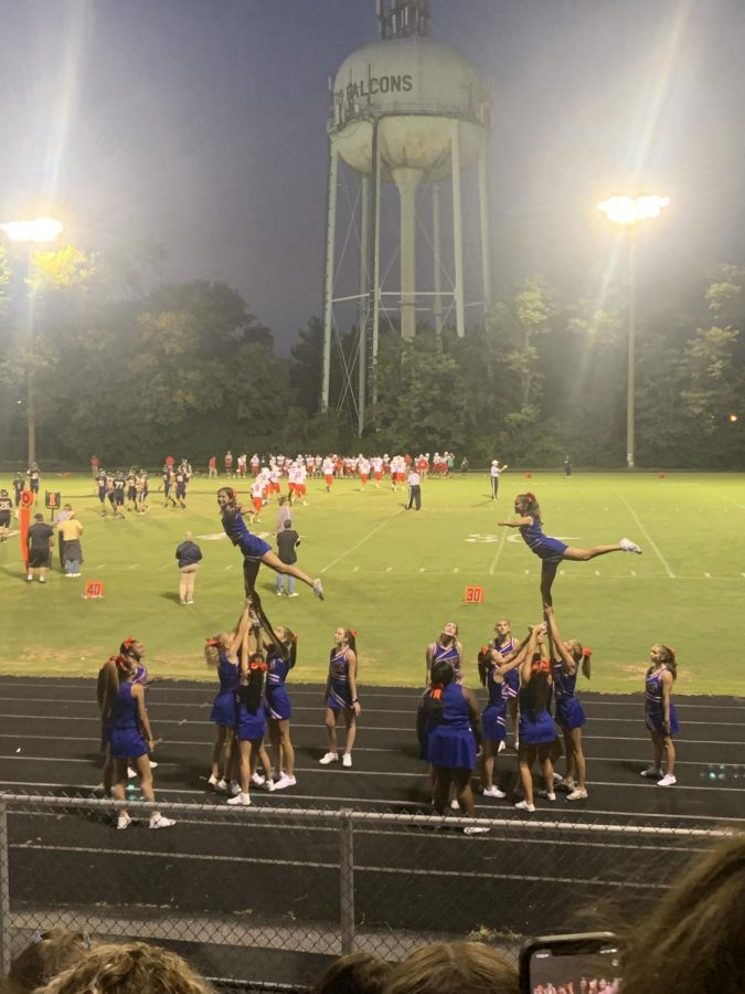 Flyers junior Josie Starr and sophomore Alexa Vinner perform a stunt at the Poolesville football game on Sept. 10.