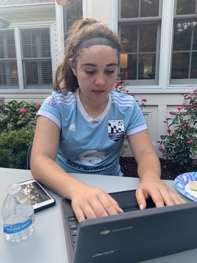 Freshman Kailey Waxman does her homework after soccer practice while at a friend