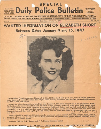 A wanted poster from 1947 shows an image of Elizabeth Short and asks for information on her disappearance.