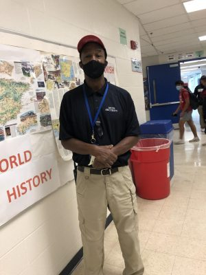 Security guard Ivan Hicks surveys the area during lunch on Sept. 17.