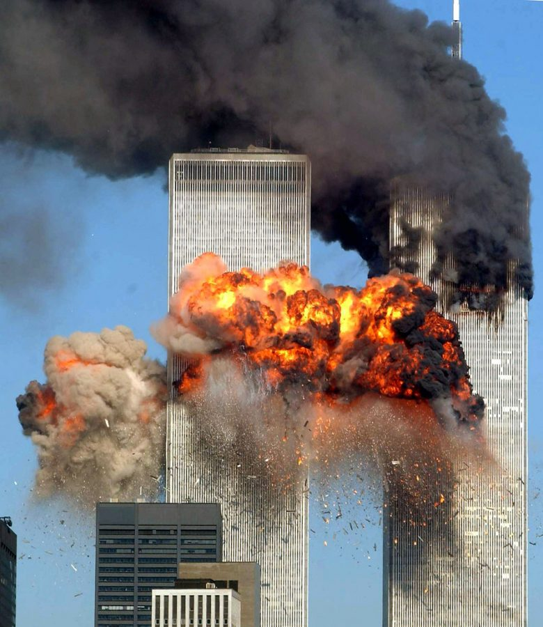 The World Trade Centers North Tower, engulfed in flames moments after American Airlines flight 11 strikes.