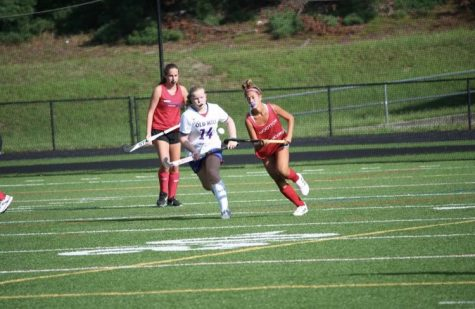 Sophomore Naomi Esterowitz  runs past the defender in a scrimmage against Old Mill.