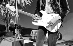Jimi Hendrix plays his white Fender Stratocaster during a live show on television in 1967.