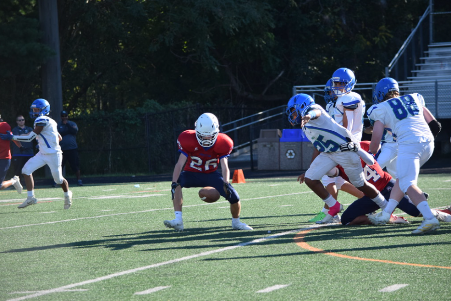 Sophomore defensive lineman Bill Gun forces a fumble and sophomore linebacker Everett Field runs it back for a 60-yard touchdown late in the third quarter to establish a 13-0 lead against Churchill.