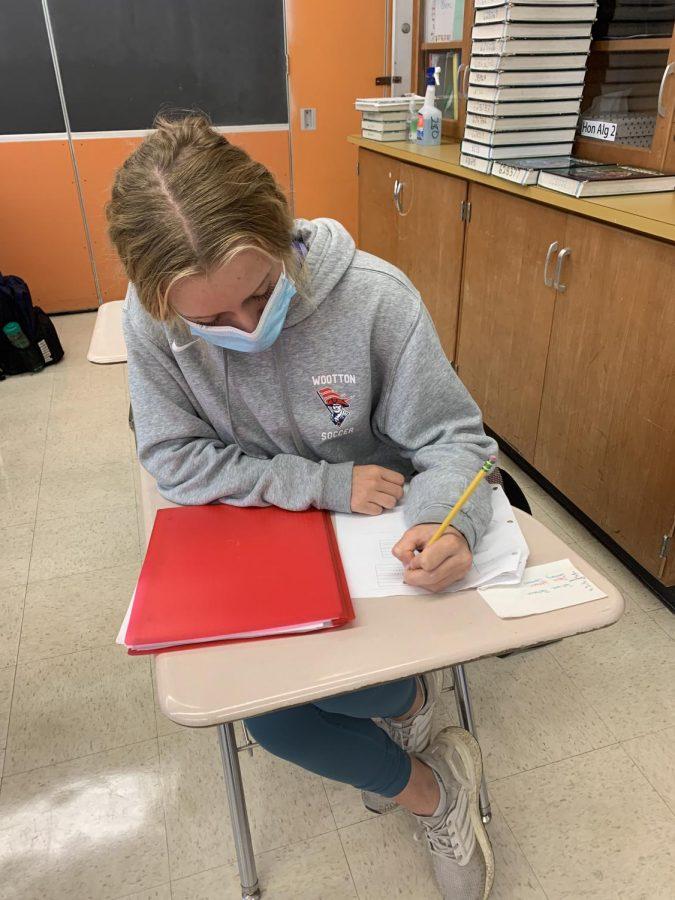 Sophomore Lindsey Mcney works on her math homework during advisory.