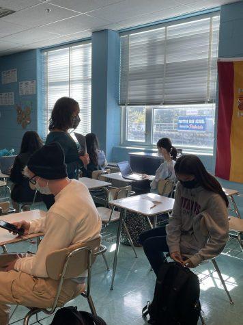 Spanish teacher Tamara Hounshell helps a student to review an assignment in her classroom.