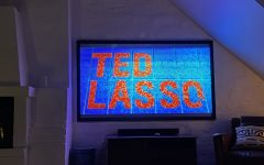A viewer watches season two of Apple TVs hit show Ted Lasso.