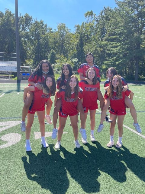 The JV girls soccer team bonds before their home opener against Quince Orchard.